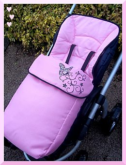Pink footmuff with butterfly and scroll