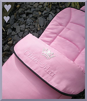 Pink footmuff with silver crown and name