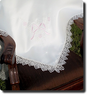 Delicate ivory baby shawl