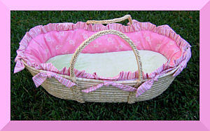 Cheerful pink cotton moses basket