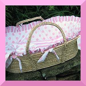 White and pink moses basket